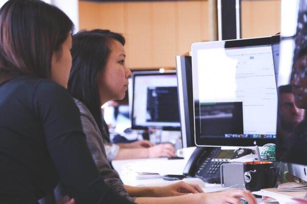 Focused team behind a computer