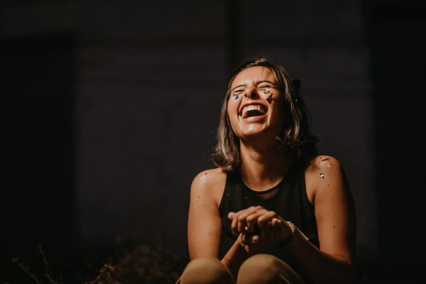 Woman covered in glitter laughing